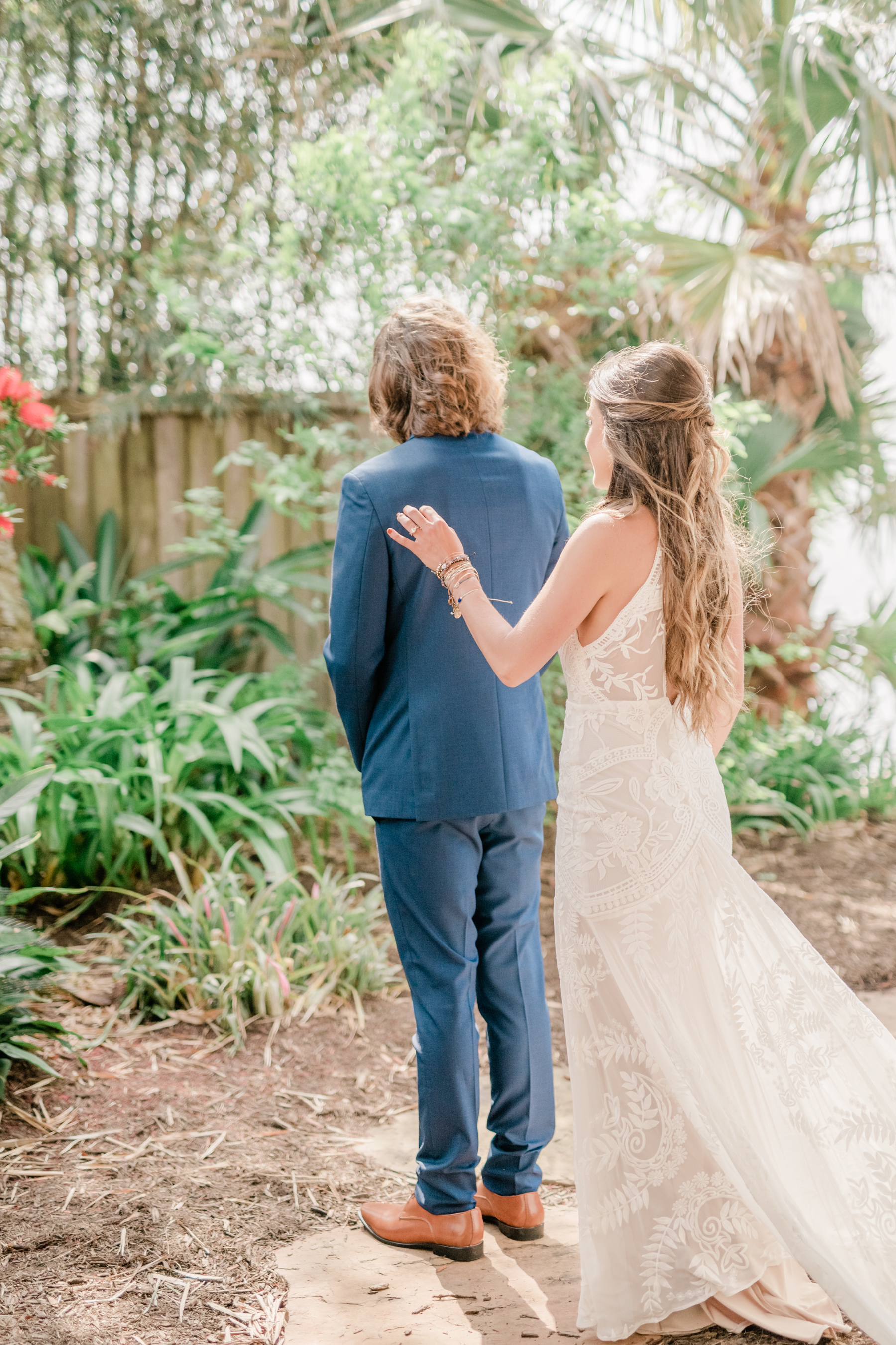 First look with groom wedding day beach galveston blue groom suit no tie inspiration + destination planner coordinator epoch co + ten23 photography