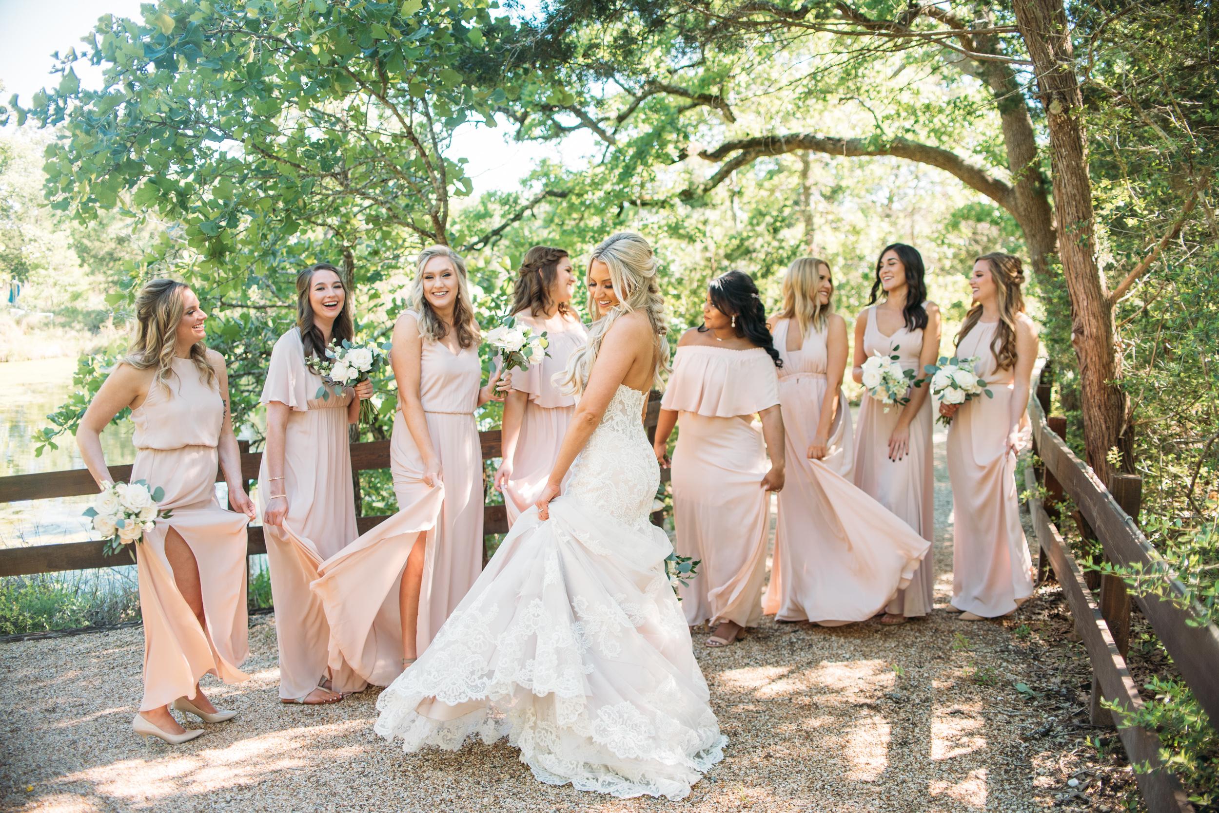 Blush mismatched bridesmaids dresses peach creek ranch college station austin wedding coordinator photographer san angel
