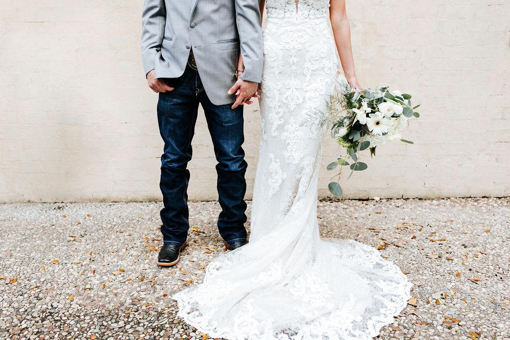 Epoch Co+ Destination wedding planner   First Look Photo Ideas with Groom   Groom Attire Jeans Grey Suit Cowboy Boots   Bridal Bouquet   Velvet + Wire Photography   Austin Wedding Planner