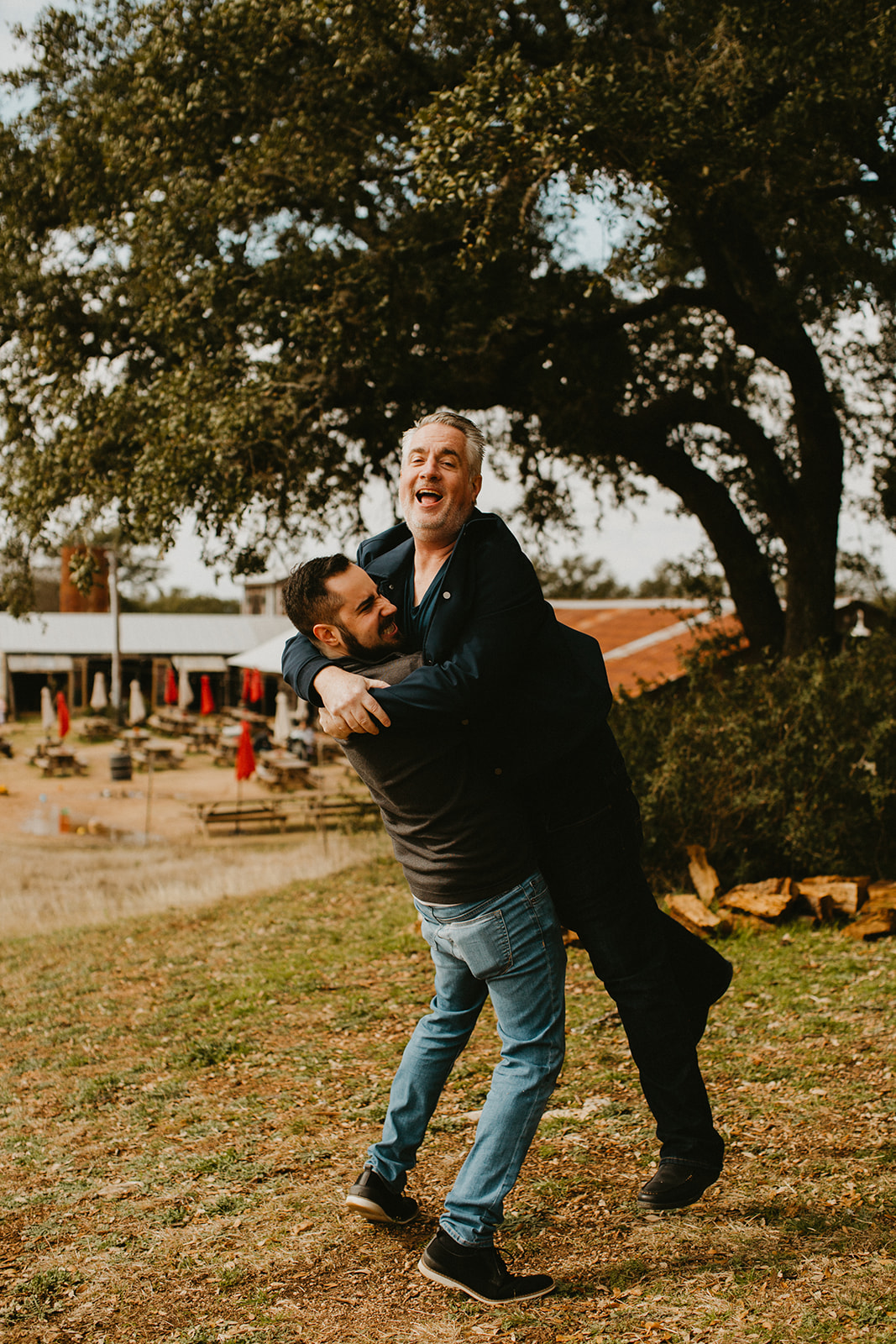 destination wedding planner + destination wedding coordinator + jester king brewery groom + groomsmen pre-wedding hangout + austin, dripping springs, texas + pizza + craft beer + father + son + dad portrait picture