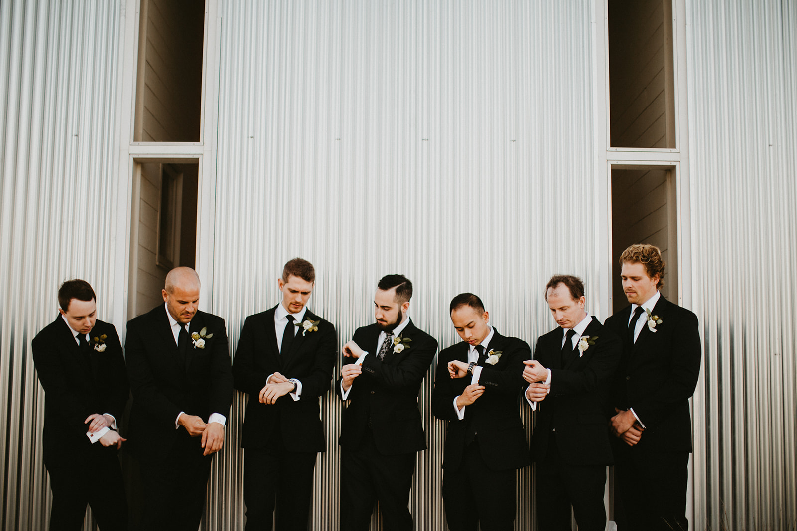 Groom Groomsmen Attire Suit + Floral Tie + Boutonnière with hops + craft brew beer + black + austin wedding venue prospect house + austin wedding planner epoch co