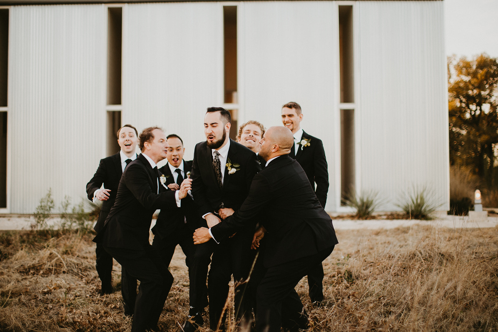 Groom Attire Suit + Floral Tie + Boutonnière with hops + craft brew beer + black + austin wedding venue prospect house + austin wedding planner epoch co