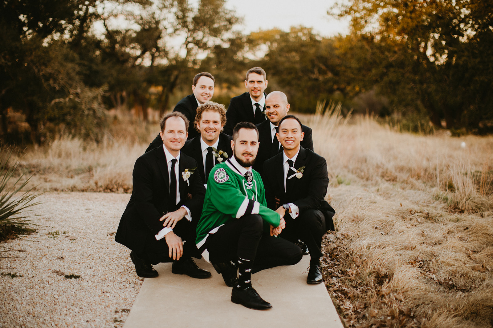 Groom Attire Suit + Floral Tie + Boutonnière with hops + craft brew beer + black + austin wedding venue prospect house + sports fan + jersey + austin wedding planner epoch co