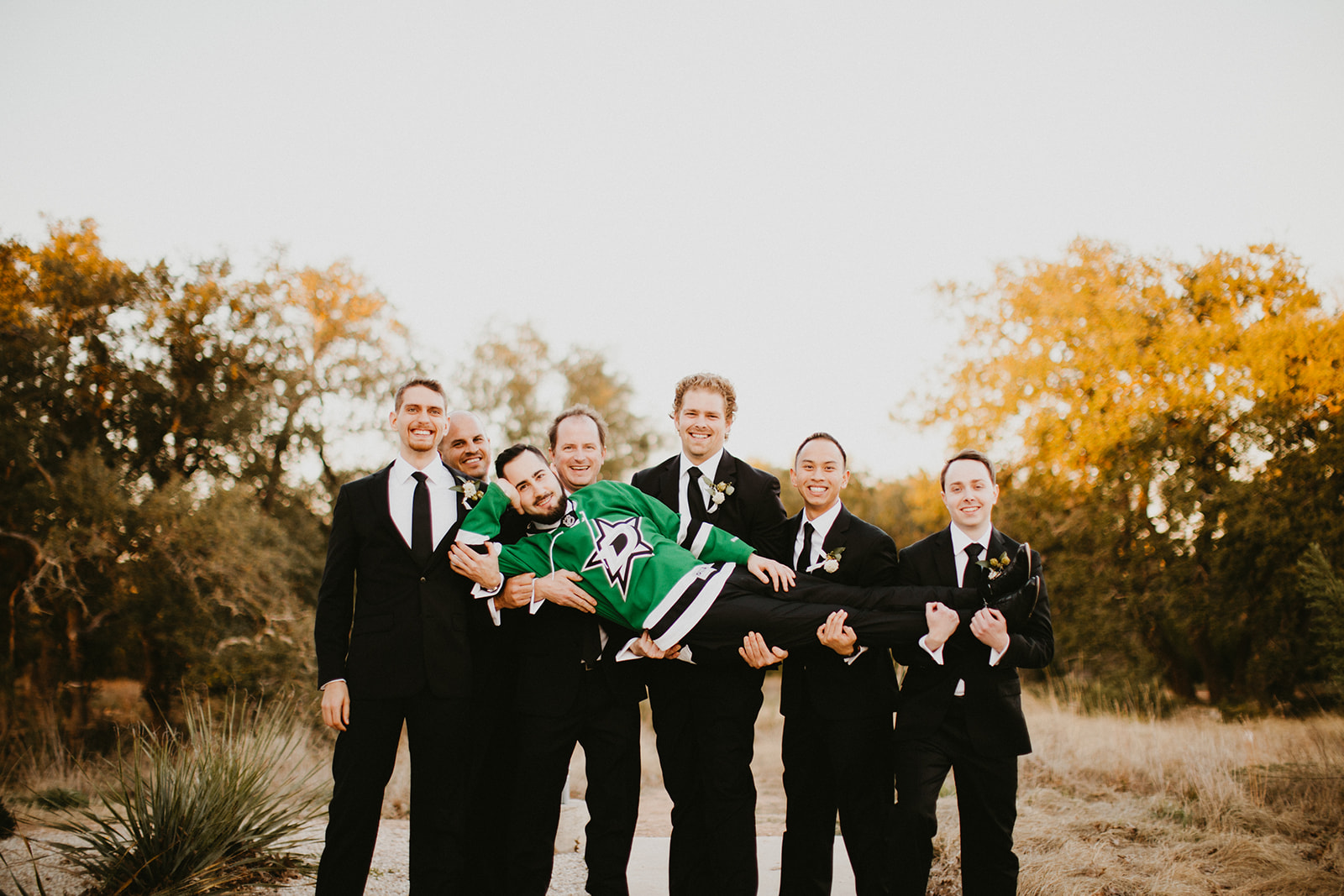 Groom Attire Suit + poses + Floral Tie + Boutonnière with hops + craft brew beer + black + austin wedding venue prospect house + austin wedding planner epoch co