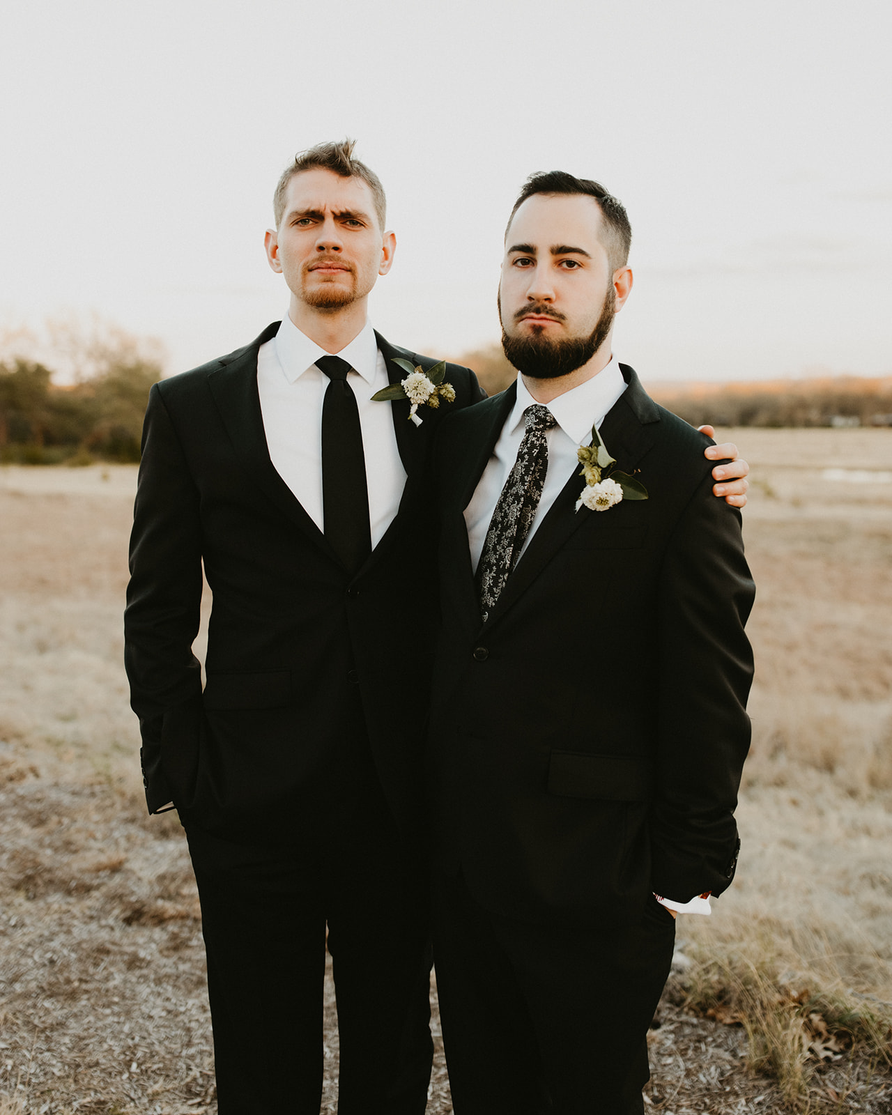 Groom Attire Suit + Floral Tie + Boutonnière with hops + poses + black + austin wedding venue prospect house + austin wedding planner epoch co