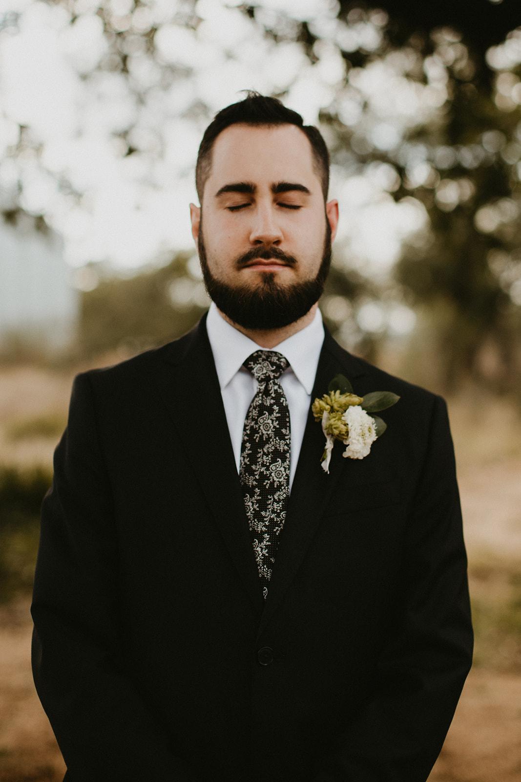 Epoch Co+ | Bride + Groom First Look | Austin Wedding Venue Prospect House | Groom Attire + Floral Tie + Hops Boutonnière  | Austin Wedding Planner