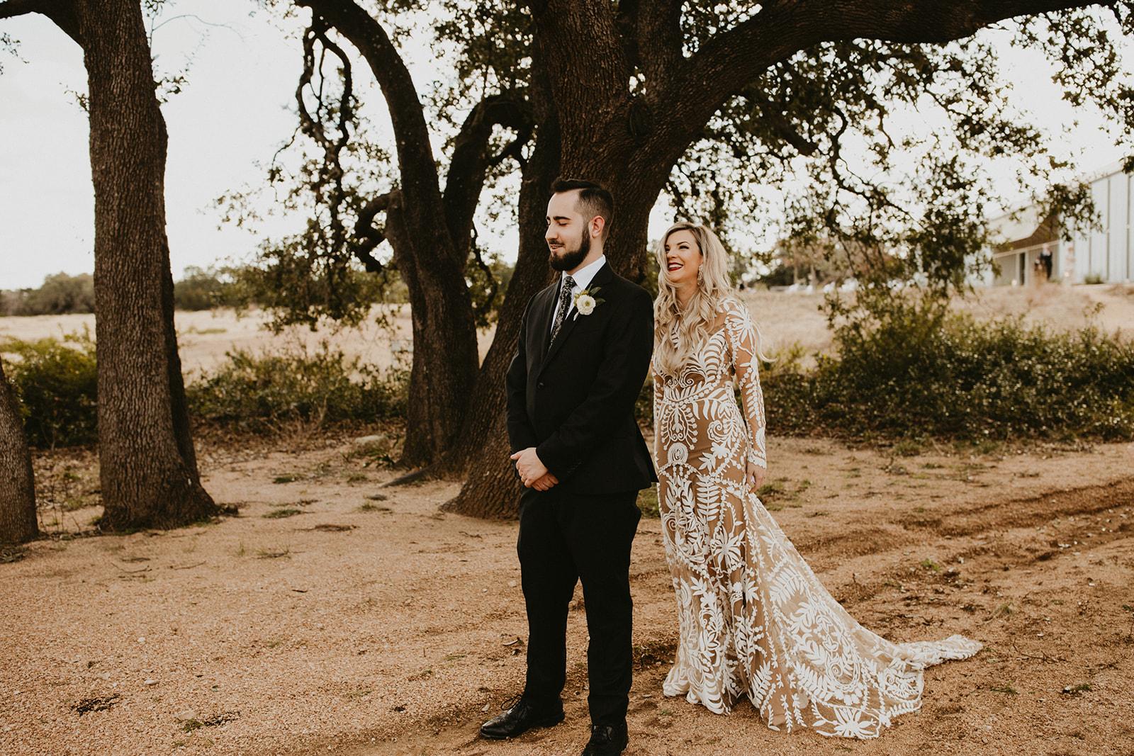 Epoch Co+ | Bride + Groom First Look | Austin Wedding Venue Prospect House | Groom Attire + Floral Tie + Hops Boutonnière + Bridal Dress Rue De Seine Nude Underskirt  | Austin Wedding Planner