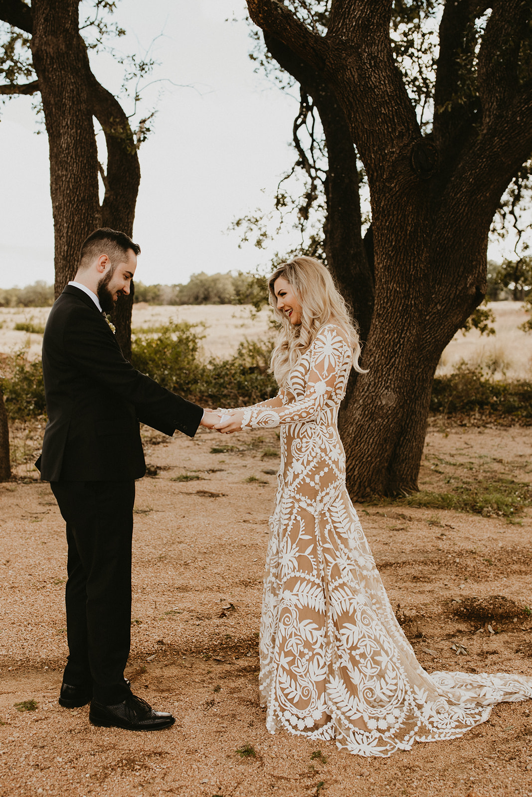 Epoch Co+ | Bride + Groom First Look | Austin Wedding Venue Prospect House | Groom Attire + Floral Tie + Hops Boutonnière + Bridal Dress Rue De Seine Nude Underskirt  + Bridal Hairstyle | Austin Wedding Planner