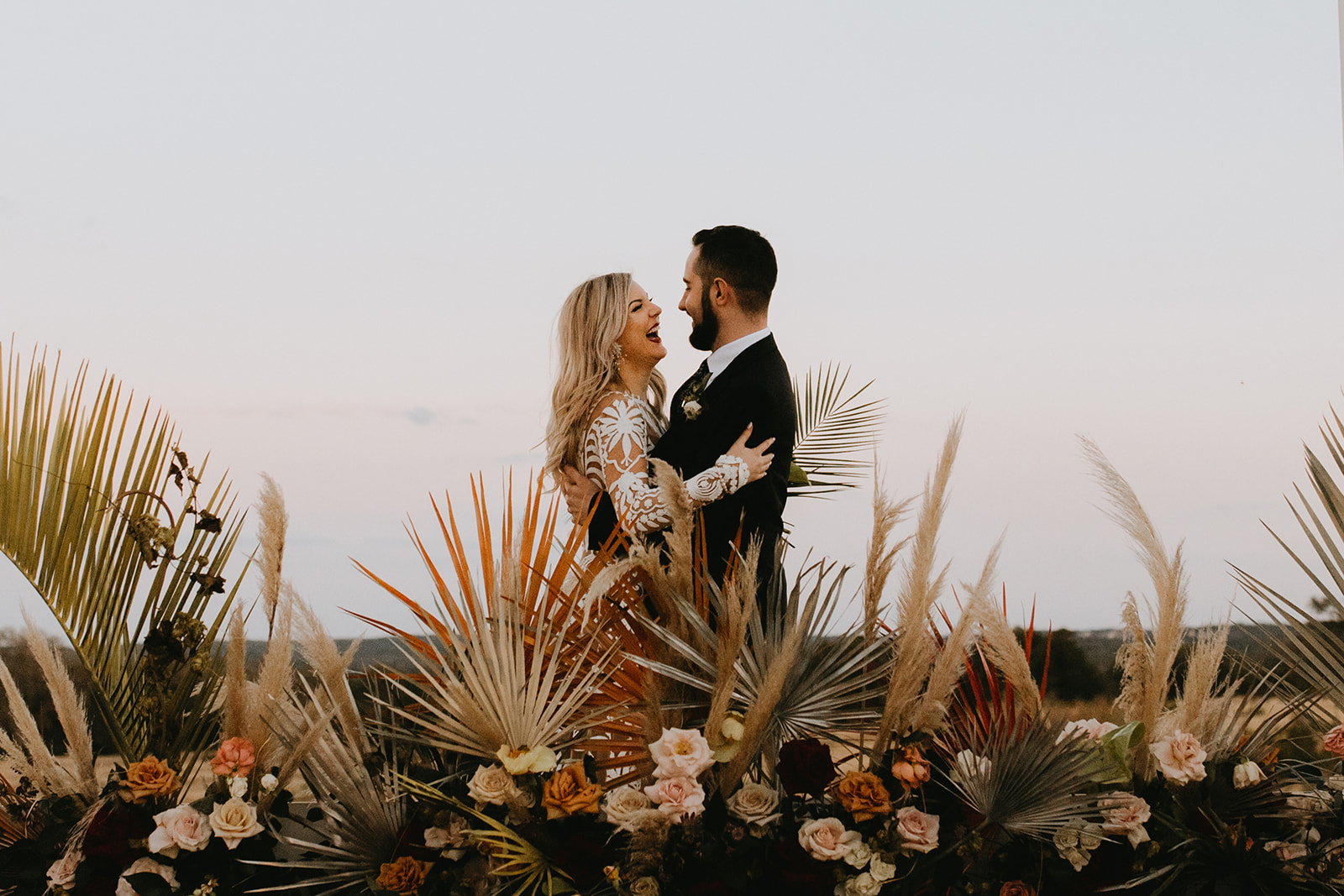 Epoch Co+ | Bride + Groom First Look Portraits | Austin Wedding Venue Prospect House | Adventure + Country + Outdoors + Moody + Wedding Ceremony Decor Florals + Colorful Tropical Palm Fronds + Boho  | Austin Wedding Photographer Century Tree Productions