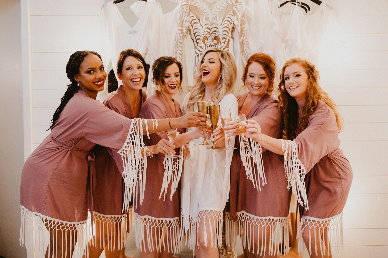 bridesmaids getting ready pictures + boho fringe robes + vintage + boho + wedding day