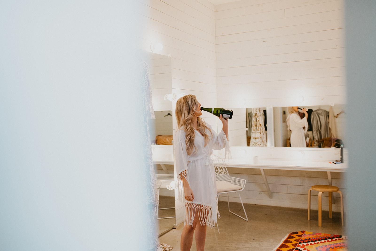 bride getting ready images + fringe boho robe