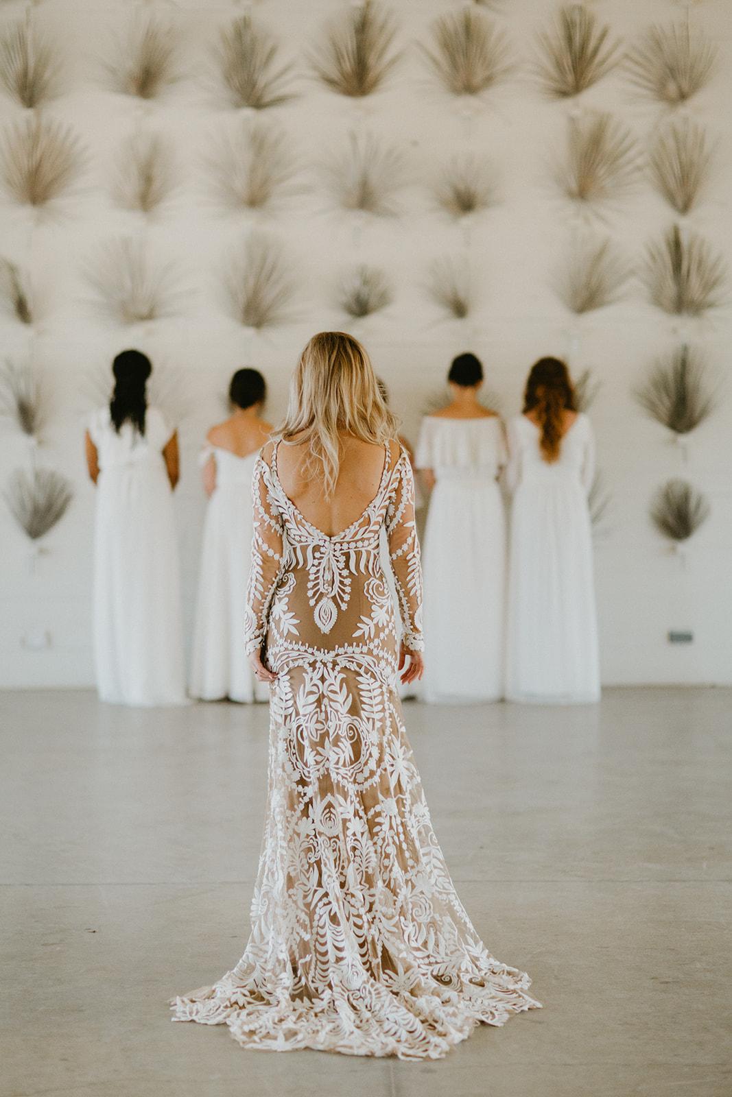 bridesmaids first look images + rue de seine wedding dress nude lining + prospect house dripping springs austin wedding venue + wedding planner epoch co