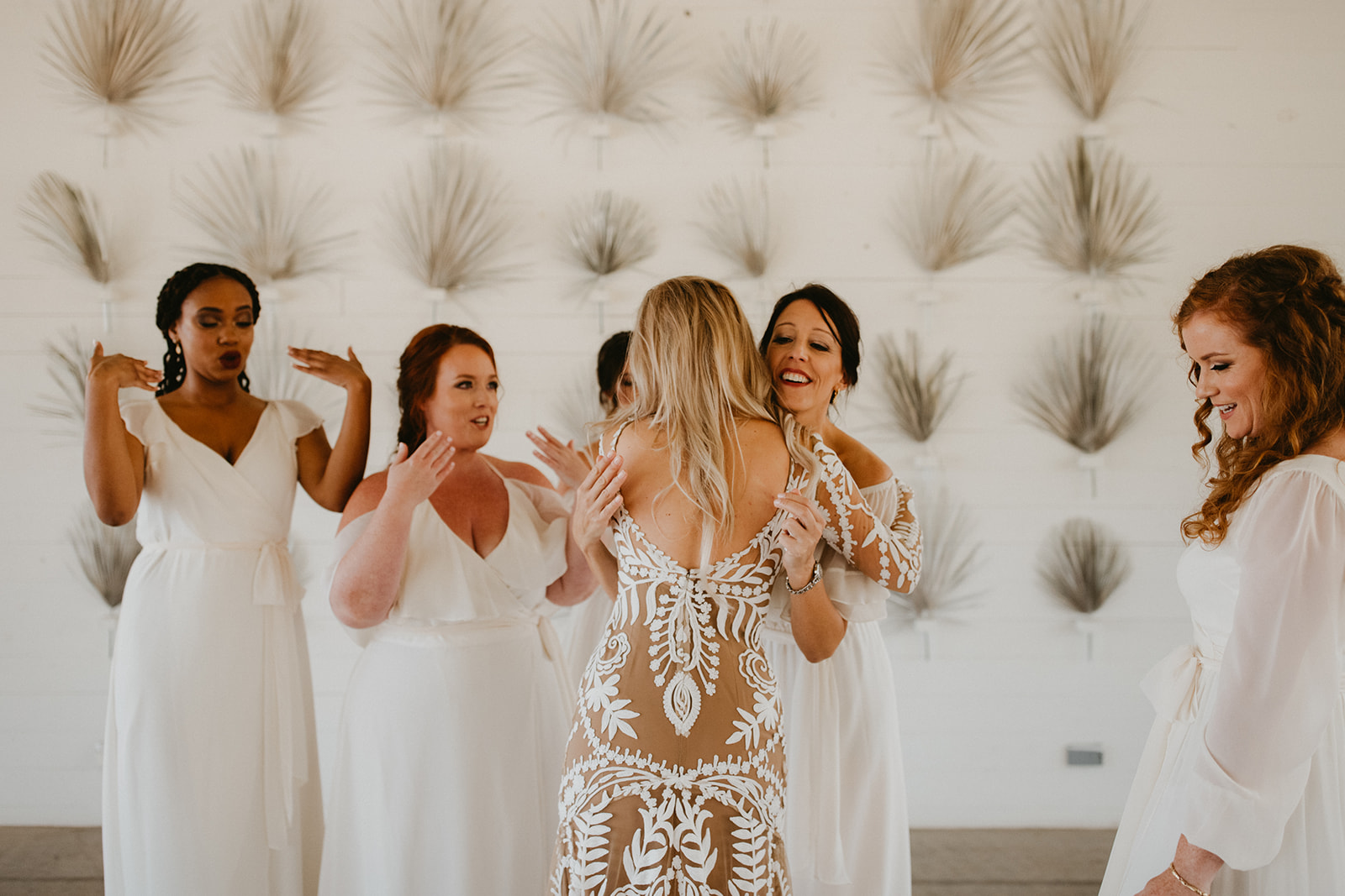 bridesmaids first look with bride + boho + tropical + modern wedding day