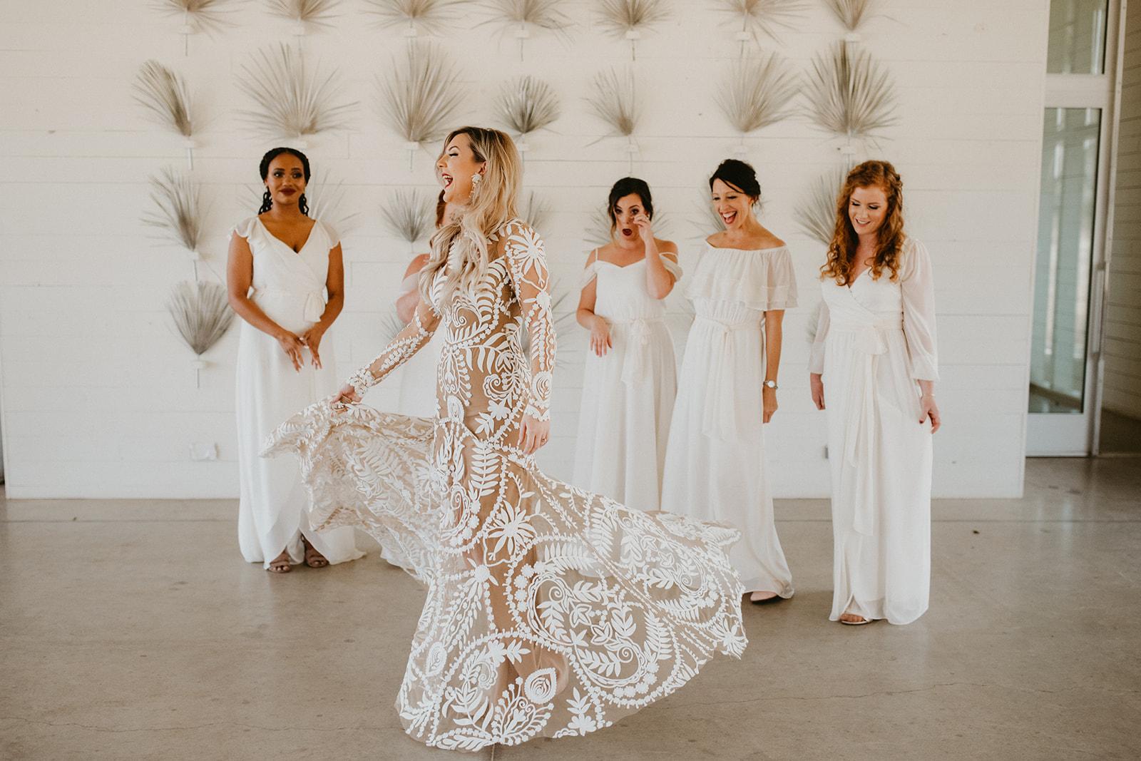 bridesmaid first look with bride + boho + tropical + modern design + wedding designer epoch co