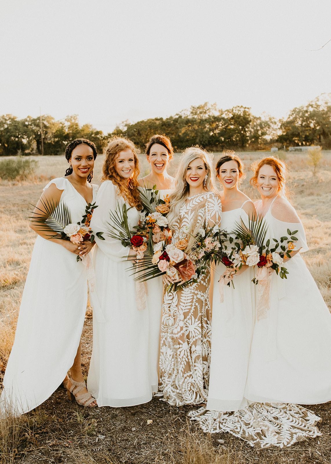 Tropical Colorful Frond Bridesmaid + Bride Bouquets + White Creamy Bridesmaid Dresses + Rue De Seine Wedding Dress + Boho Wedding + Wedding coordinator Planner Epoch Co+