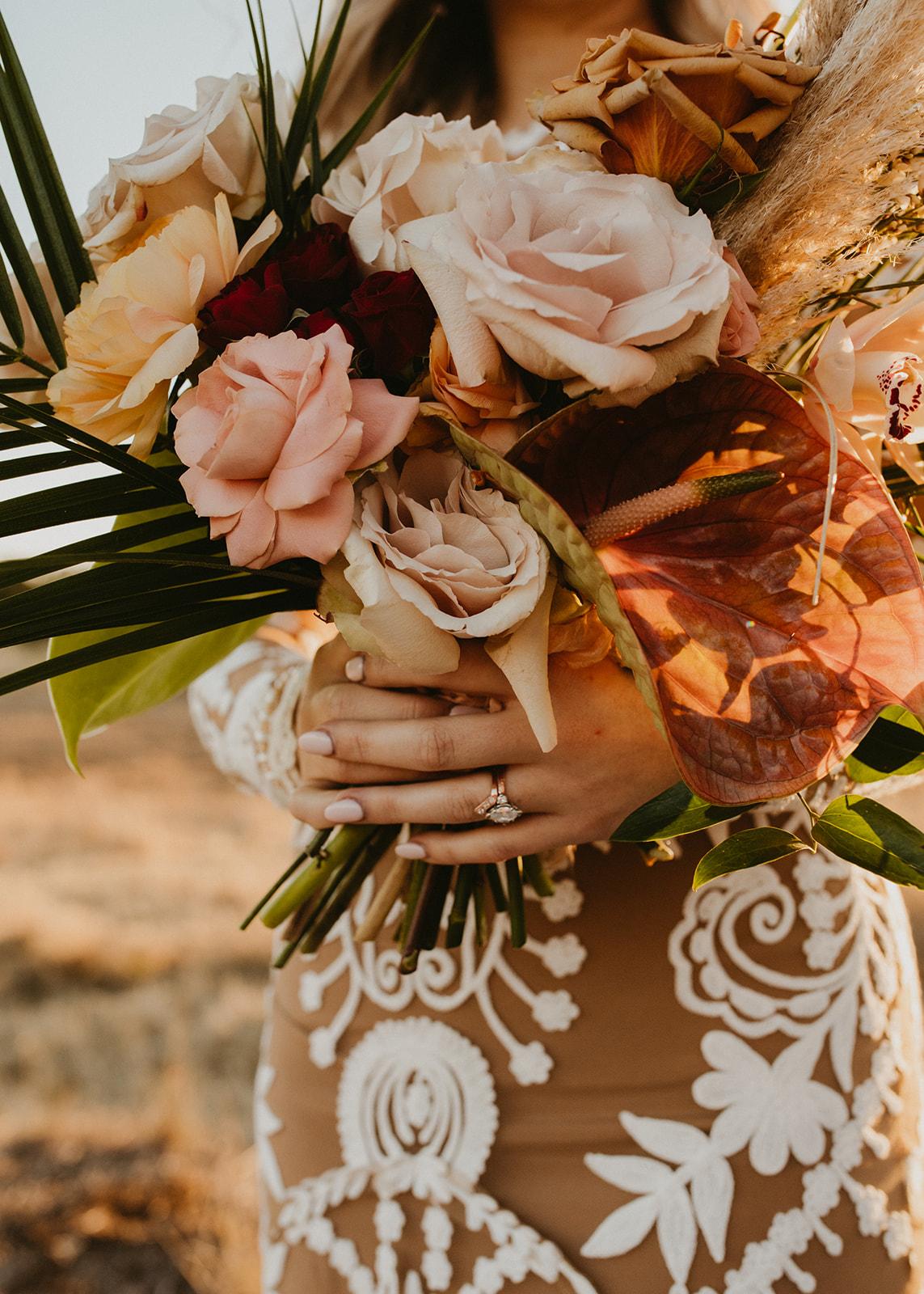 bridal bouquet + diamond ring + jewelry + boho, tropical, colorful bride bouquet + prospect house wedding + wedding planner epoch co