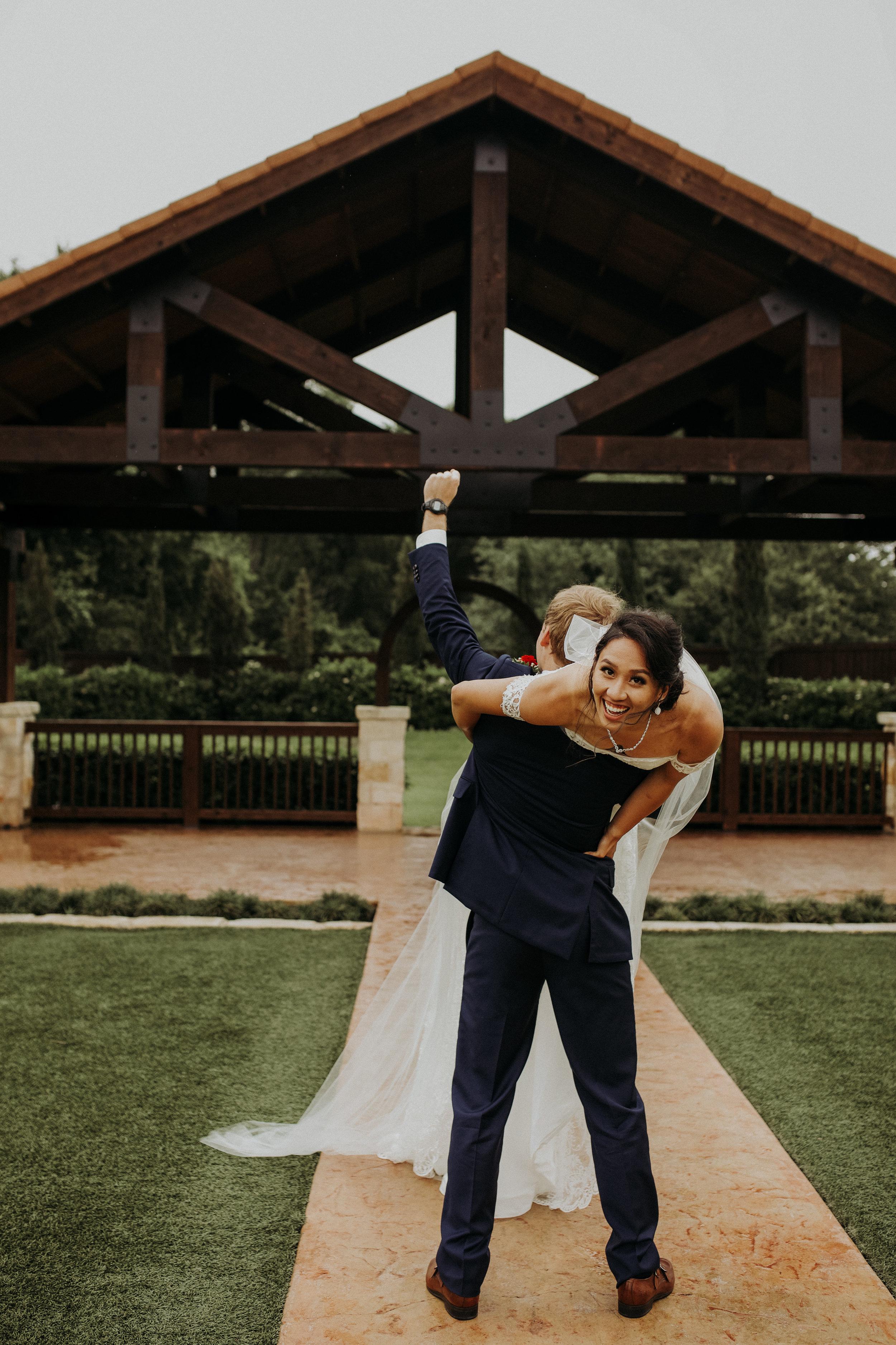 The Springs in Katy || Groom Holding Bride Fist Pump || Houston Wedding Planner
