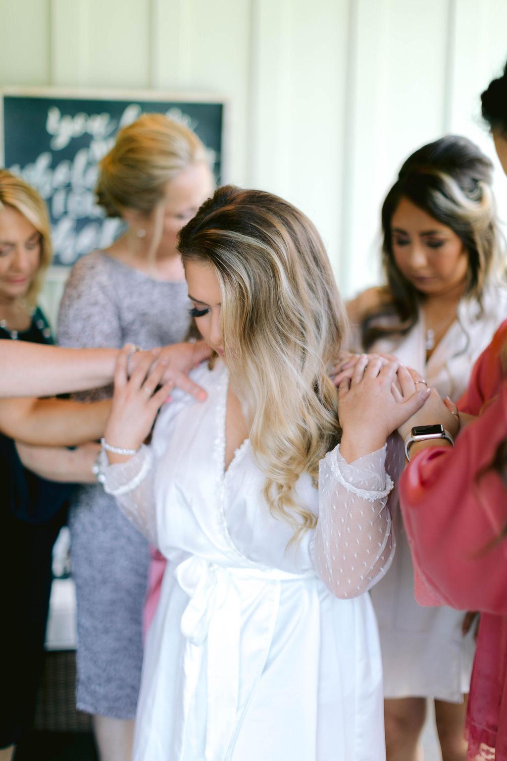 Bridesmaids Praying Over Bride | The Vine at New Ulm | Austin Wedding Planner