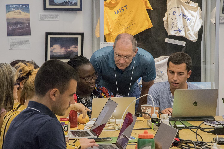 Keith Oleson helps tutorial students run CESM. Photo:  @NCAR_CGD
