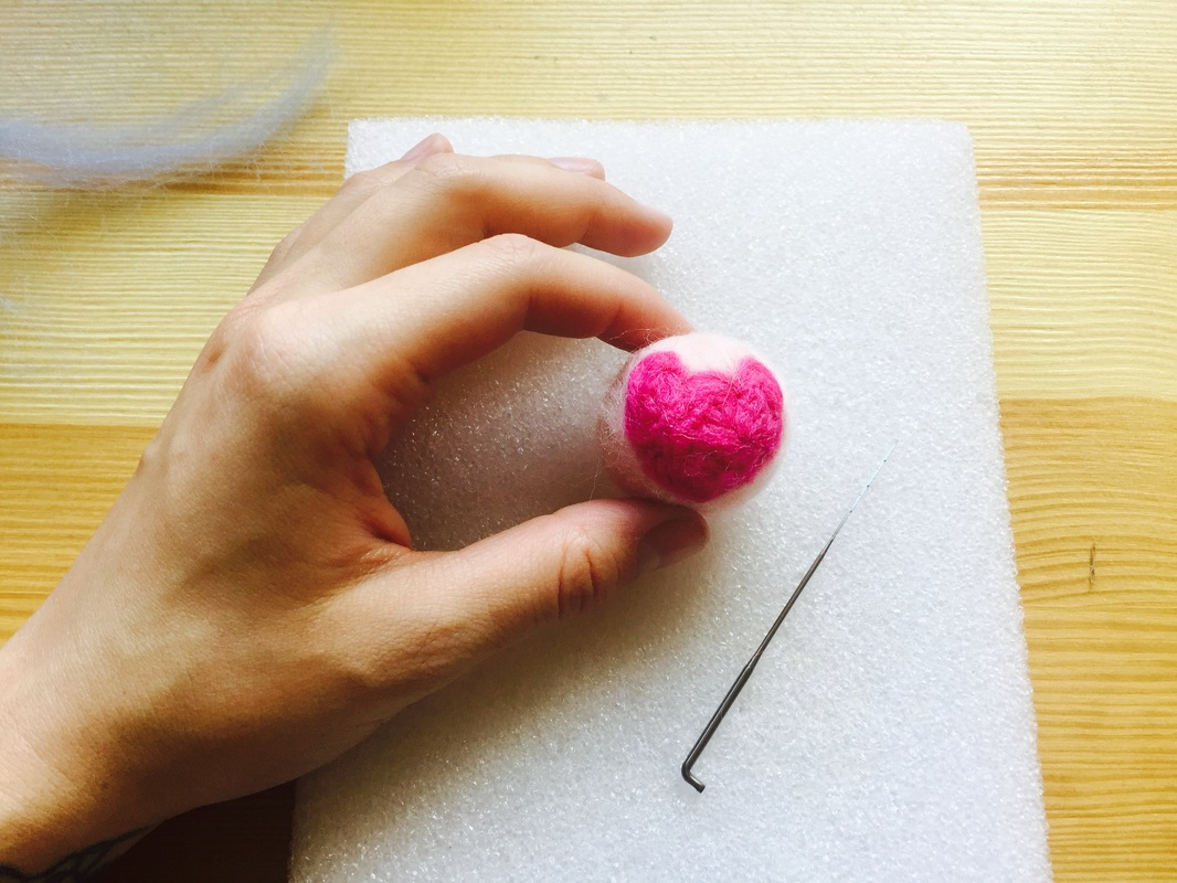 STEP 7: Add any extra wool needed to shape your ball and secure to the base.