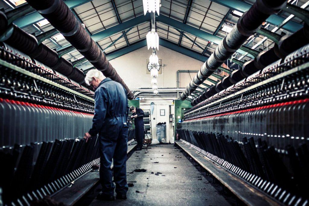 Wool spinning machines at Harris Tweed Hebrides | Photography by Harris Tweed