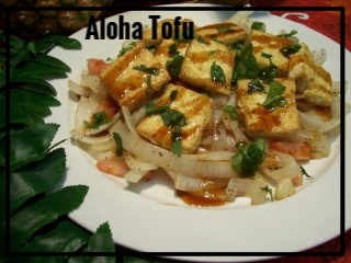 ALOHA TOFU SALAD   A dish that will bring a smile to any vegetarian. Firm tofu is sauteed in sesame oil and served on a bed of lightly sauteed Maui onion, tomato, garlic, ginger, and toasted sesame seeds. Finally, this hot salad is topped with a delicious teriyaki sauce & freshly diced cilantro leaves. Medium Tray - sufficient for approximately 10-15 guests, $65 Large Tray - sufficient for approximately 20-30 guests, $120