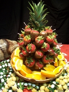 STRAWBERRY/PINEAPPLE DISPLAY   Large, ripe strawberries are double dipped in white chocolate and individually arranged on a full pineapple display. A beautiful addition for tropical buffets or use as table centerpieces.  32-40 strawberries per arrangement. Each arrangement, $90
