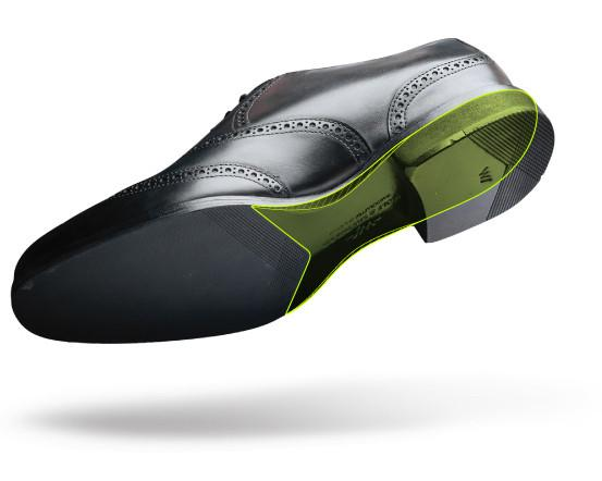 Carbon Fiber Shank  - Adapted from the carbon fibers used in race cars, the carbon fiber shank in our shoes offers lightweight support. Carbon fiber makes speedy cars lighter and more powerful, which is exactly what this material adds to Wolf & Shepherd dress shoes. The Carbon Fiber Shank adds unbreakable, weightless strength to allow our shoes to give you the structure and arch support your feet need while keeping you light and fast on your feet.