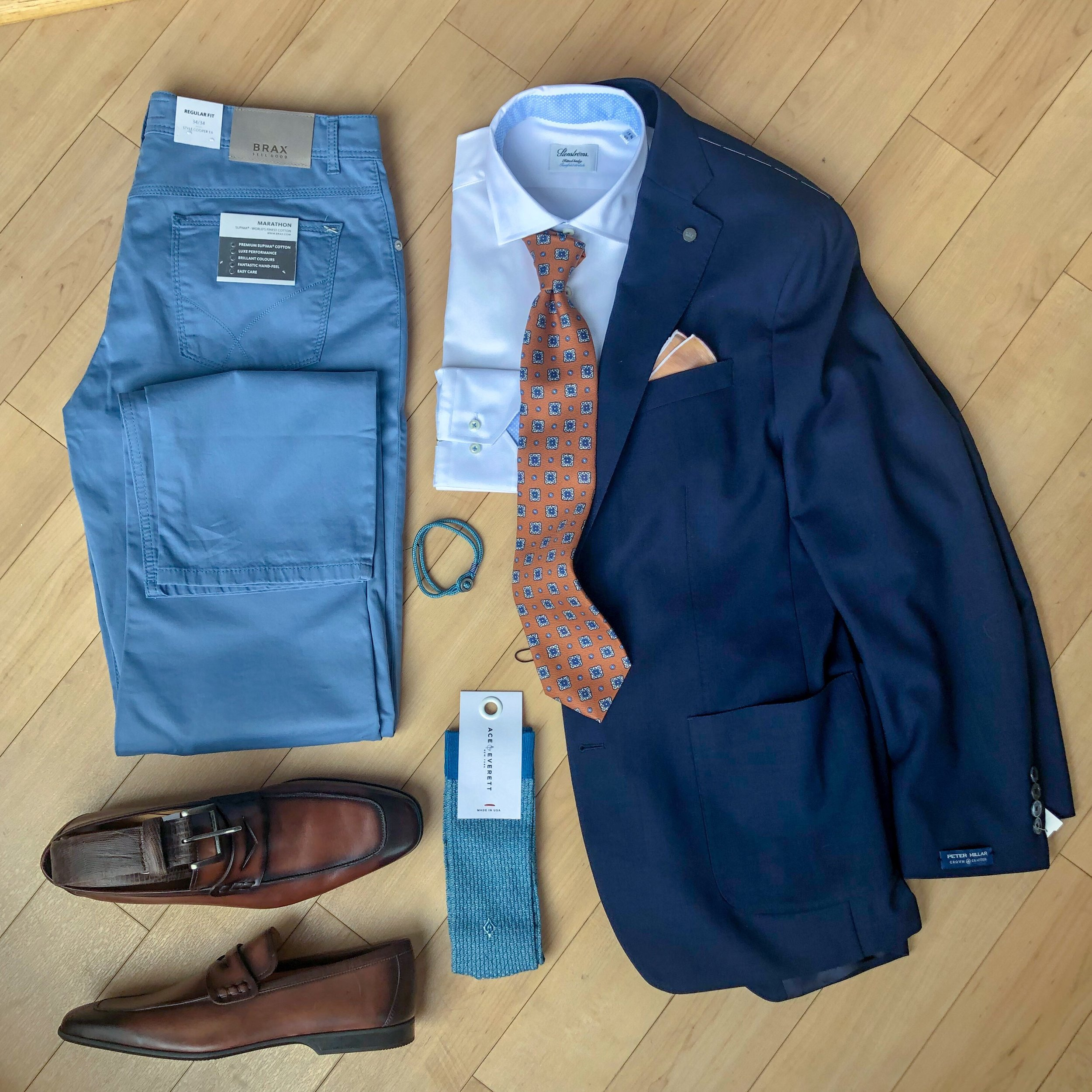 Add Some Color To Your Denim Wardrobe - Surprise everyone at the office with a pop of color. Brax colored denim paired with your favorite navy blazer and a Magnanni loafer will have you working with confidence and style.