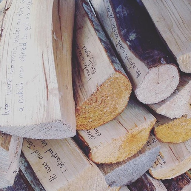 Sauna memories written on the logs + stacked for use later. Viccy Adams, Compass residency 2016.