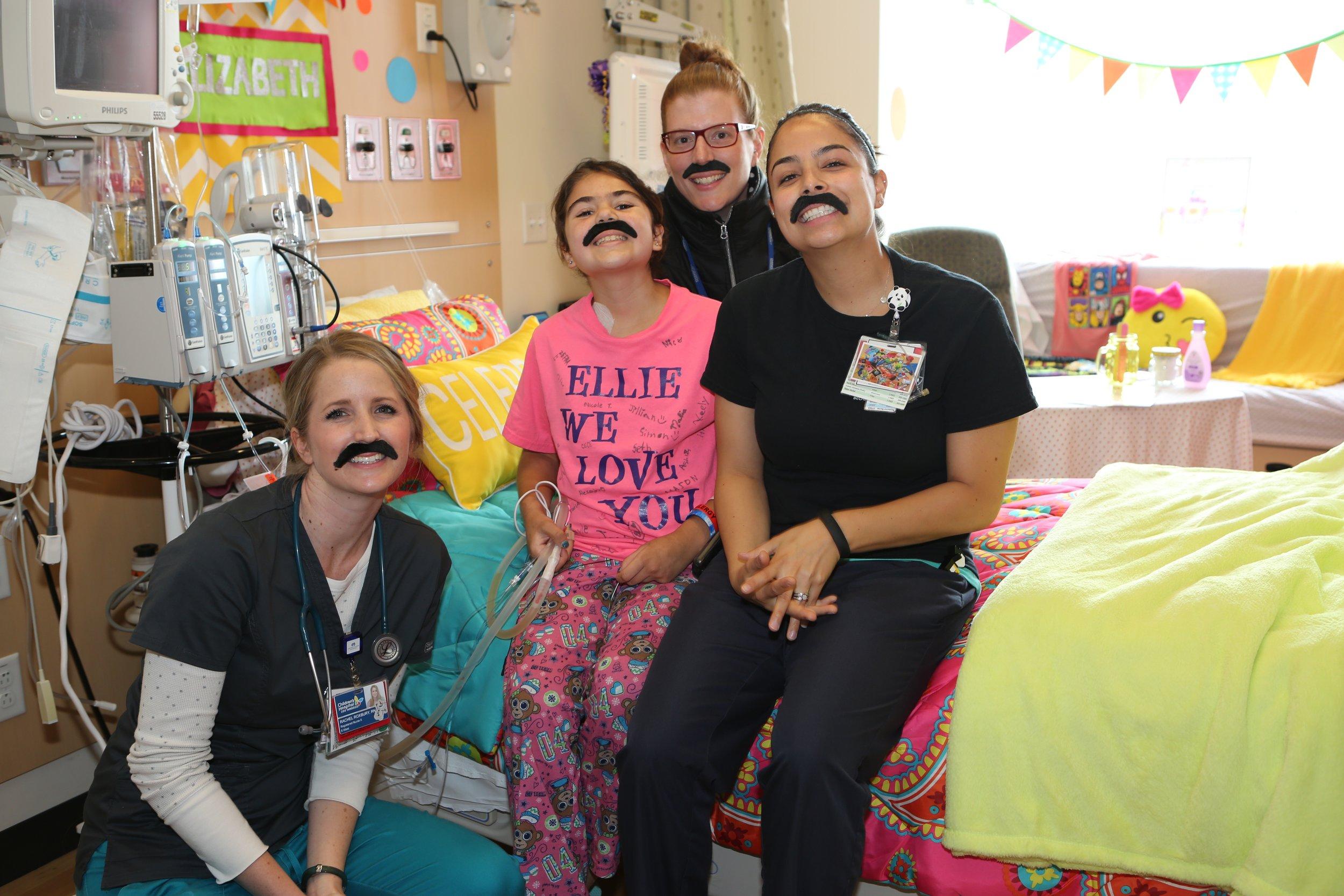 mustache ellie and staff.jpg
