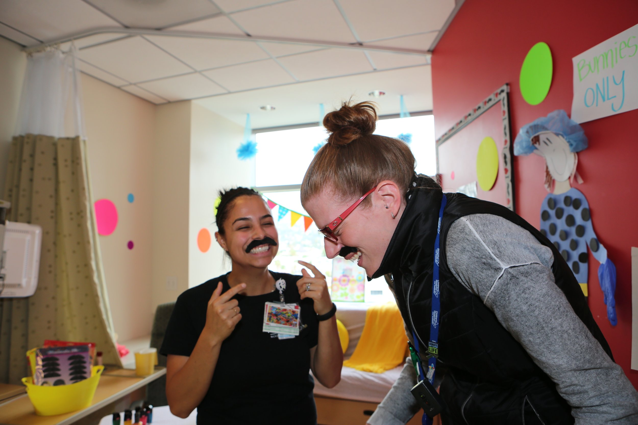 mustaches staff laughing.jpg