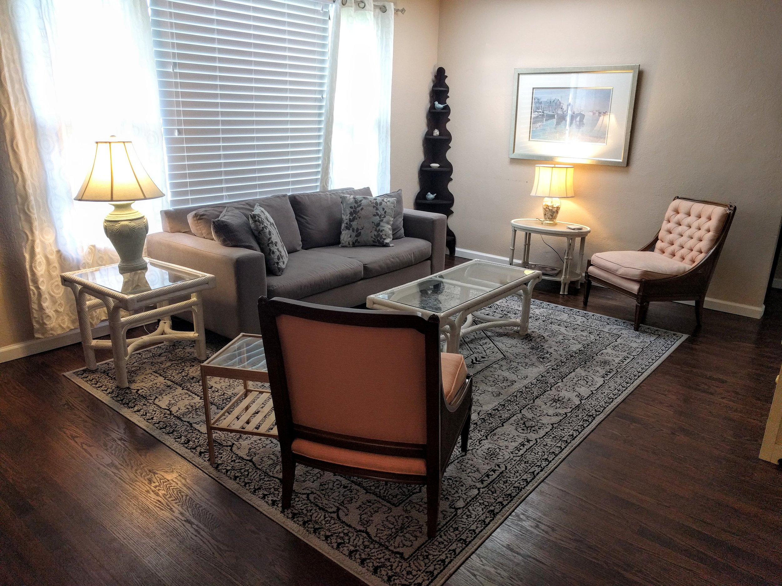 New couch, tables, rug.