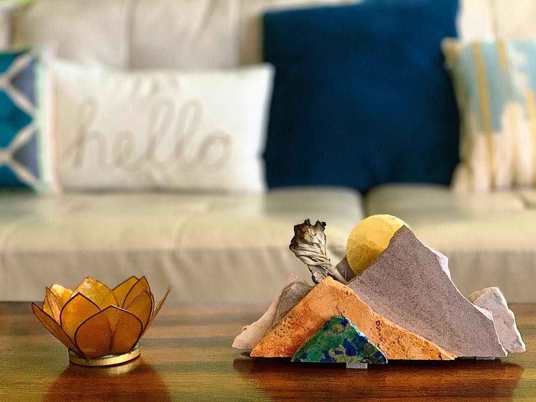 The Abundant Host lives in a city at the foot of the mountains; here, she brings the mountains inside her home with some sage for guests to enjoy.