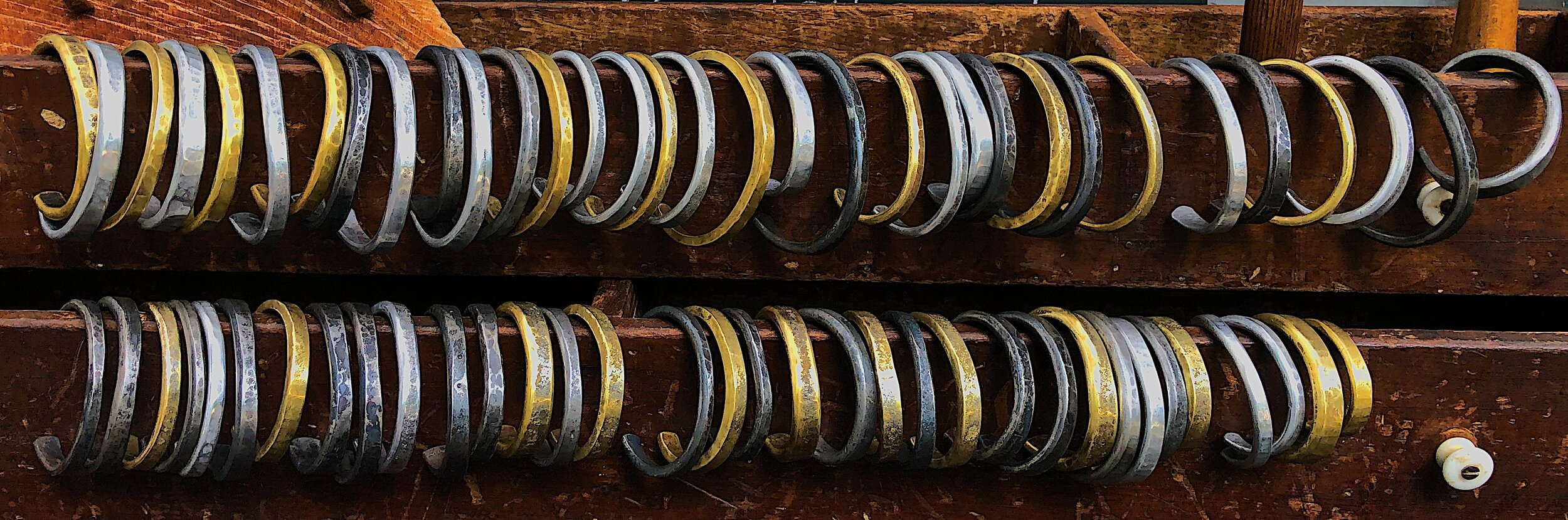 NCF Bracelets - Hand forged in solid brass, aluminum, and steel.