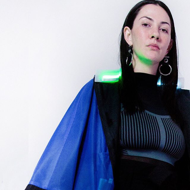 Watch out 👀🛑Our latest release has landed 🚁🚨Check out our new sound interactive crop jacket. Features our modular sound reactive collar with a black waxed cotton exterior, and an electric blue mesh lining. ⠀⠀⠀⠀⠀⠀⠀⠀⠀ Want to wear the crop jacket now? DM us to rent it! ⠀⠀⠀⠀⠀⠀⠀⠀⠀ Model: @stephanieberzon, Founder of Residency Earth #capsulecollection #madeinnyc #fashiontechnology #interactivefashion #interactivestreetwear #soundinteractive #capsuleyi #wearablemedia #newyorkcity