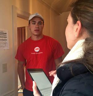 Friends of Rigby volunteer Tara Flanagan, 21, administers a fire safety survey on April 9, 2016 to Georgetown University senior William Paolella, 22.  Photo credit: NBC Washington