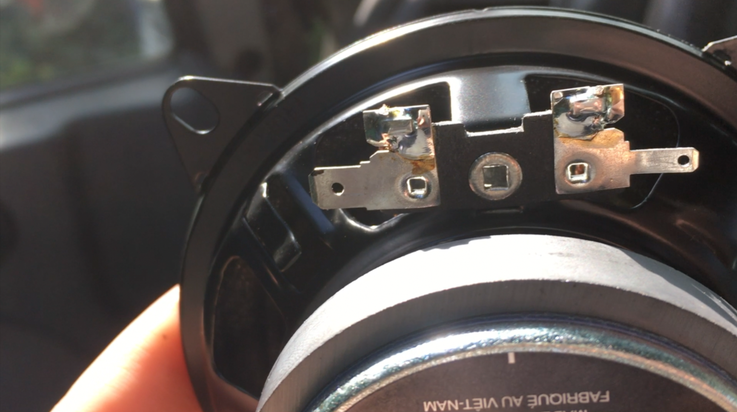 Metal tabs that must have wires attached to them (new speakers)