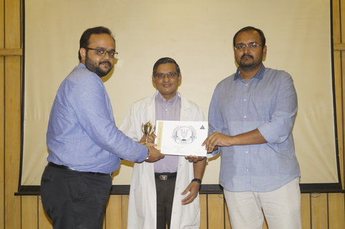 Dr.Vivek Narayan getting the 'Workaholic staff award' for the year 2017 from the Director of Academics