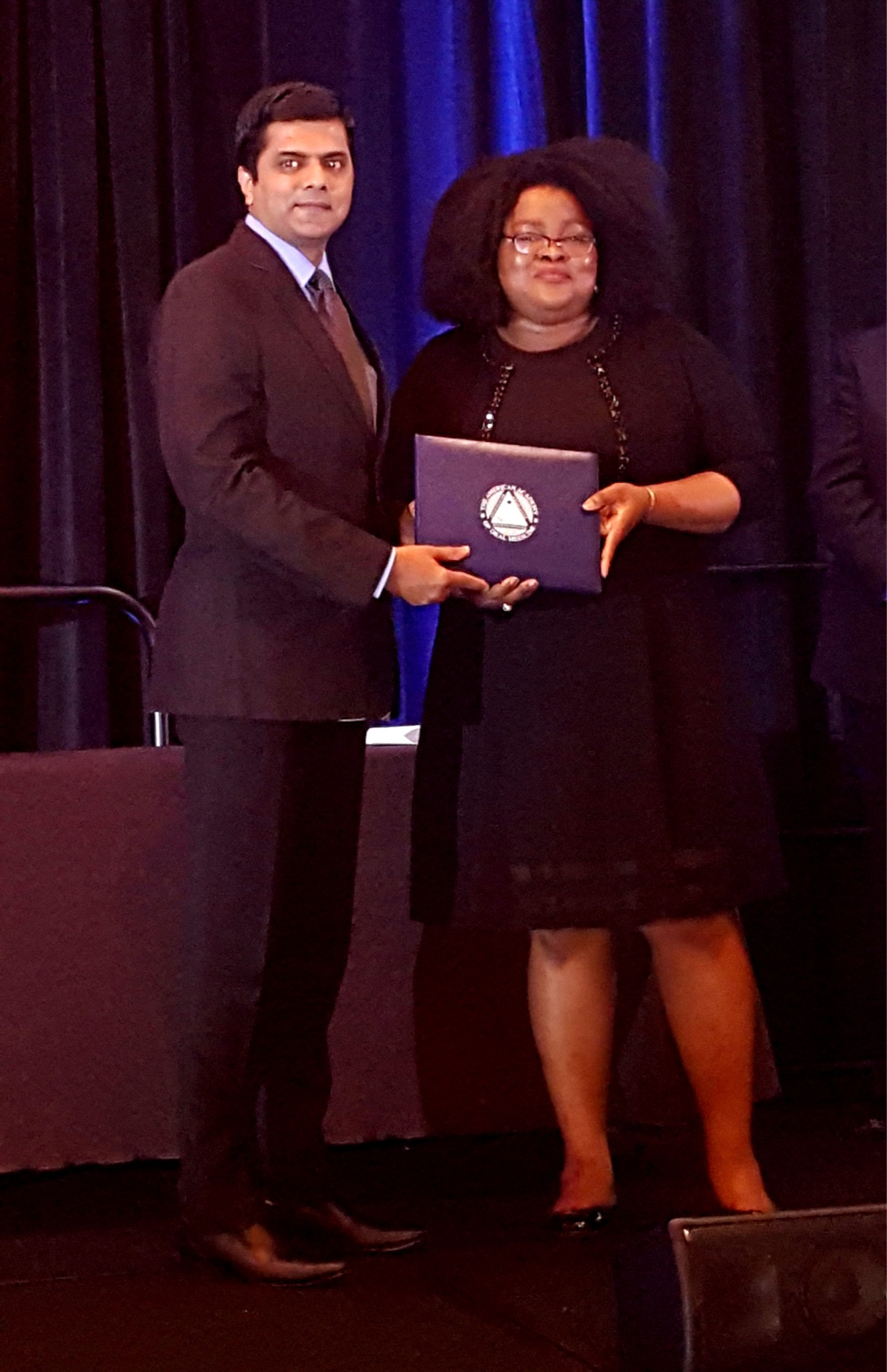 Dr.Arvind Muthukrishnan getting the certificate and medal for passing the academic fellowship exam conducted by American Academy of oral medicine. The fellowship was awarded at San Antonio in Texas in 2018