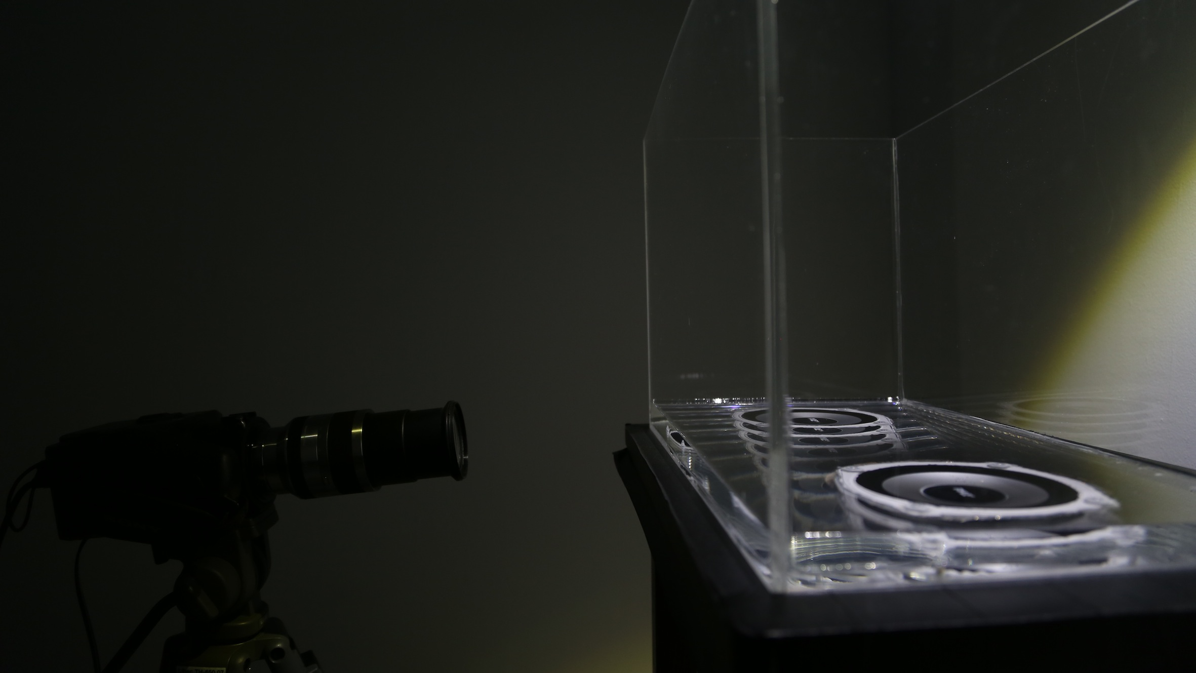The Invention of Landscape, 2013. Mixed media with infrasound, signal generator, amplifier, waterproof speakers, water, light, large-sensor camera, live projection. Photo: B.Hagari