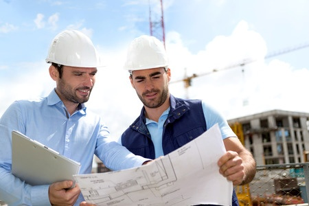 41604888-view-of-an-engineer-and-worker-checking-plan-on-construction-site.jpg