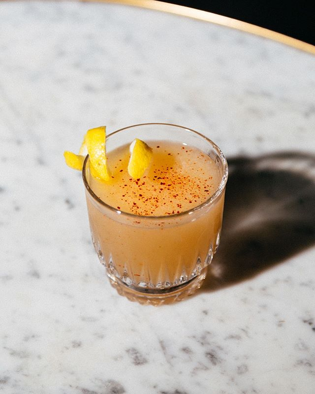 A Marble Lettered Brag, one of our new cocktails with Moonshine, Cacao-Chili Demerara, Lemon, and Smoked Apricot Bitters  #cocktails #moonshine #whiskey #cocktailweather