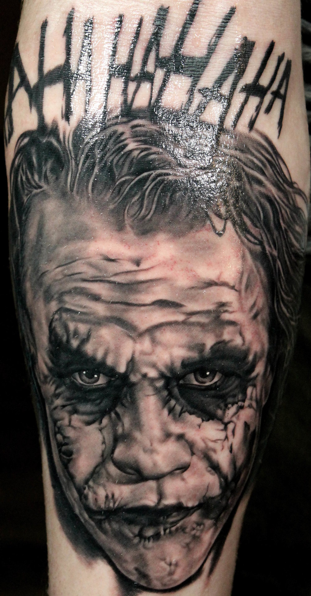 Cardinal Tattoo's resident realism artist, Will, completed this awesome portrait of Heath Ledger as the Joker from the Dark Knight series of Batman films. Regarded by many as the best portrayal of the character ever, we feel like Will did this 10 hour piece justice. If you're in the greater Nashville or Hendersonville areas an are interested in black and grey or color portraiture or realism, Cardinal Tattoo is the place for you!