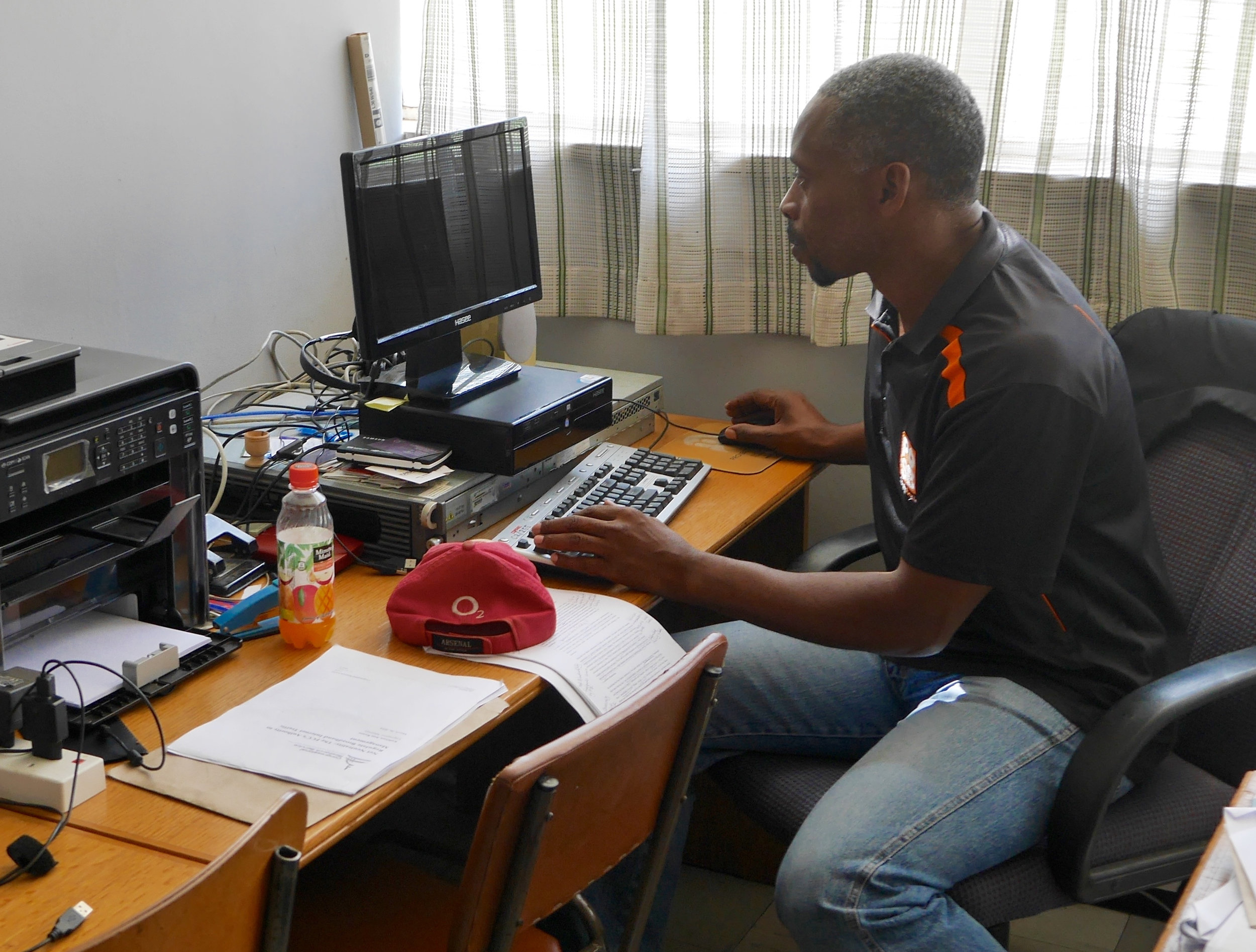 Dr. Sam Takavarasha, Jr. in his office at the U. Z.