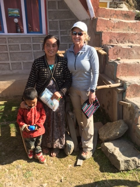 A Red Panda trekker with a local woman in Sherpa Gaun.
