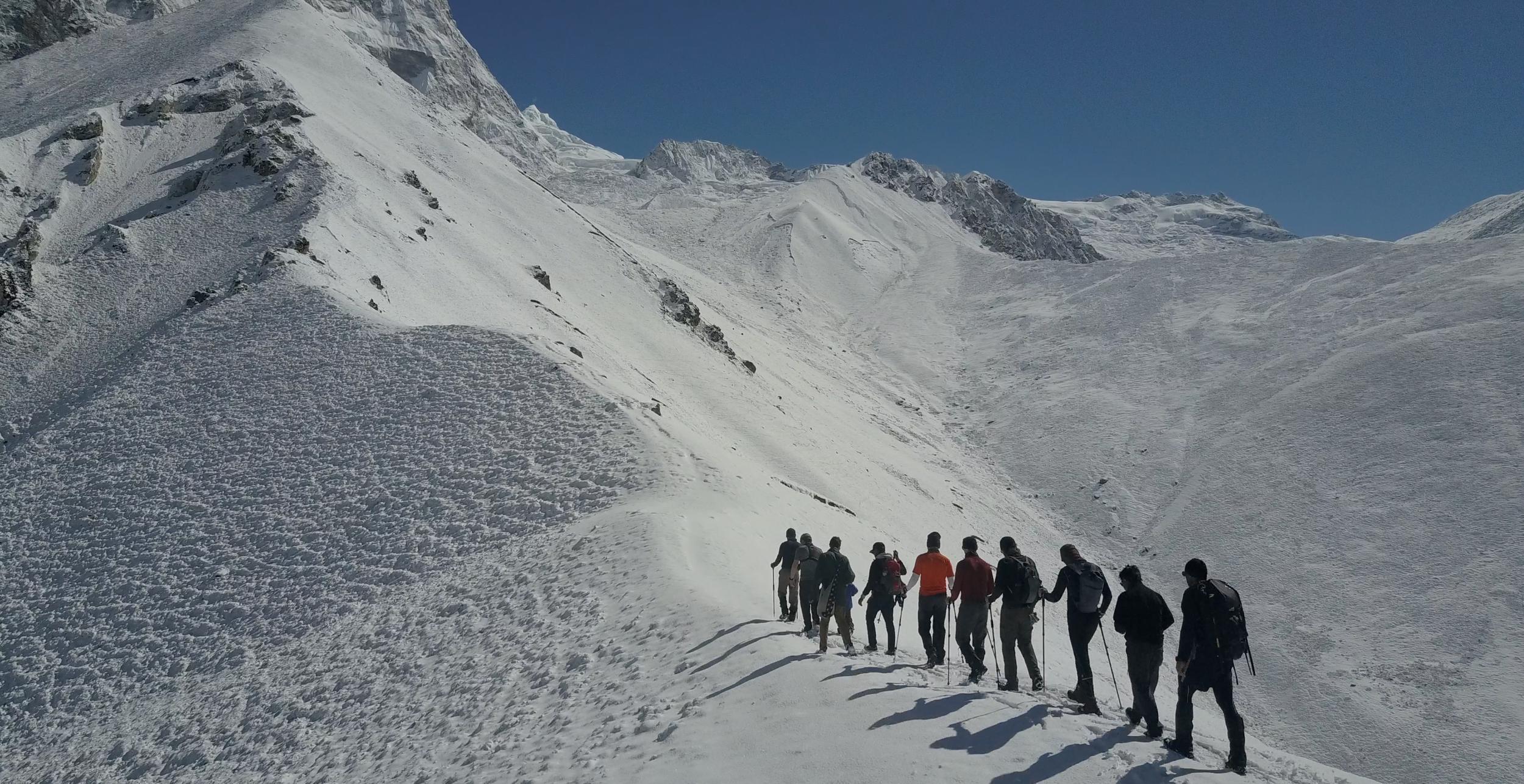 A Red Panda group climbs the ridgeline of Kyanjin Ri near Kyanjin Gompa.