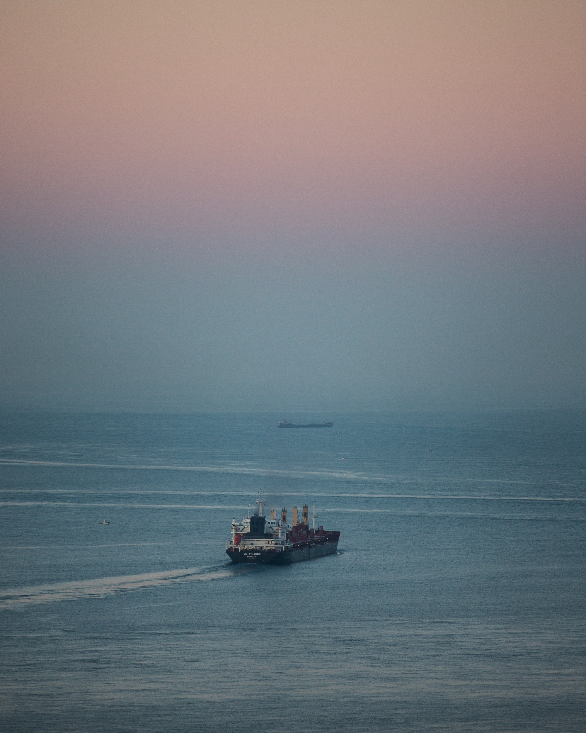 Cargo ship makes his way through the Bosporus at dawn