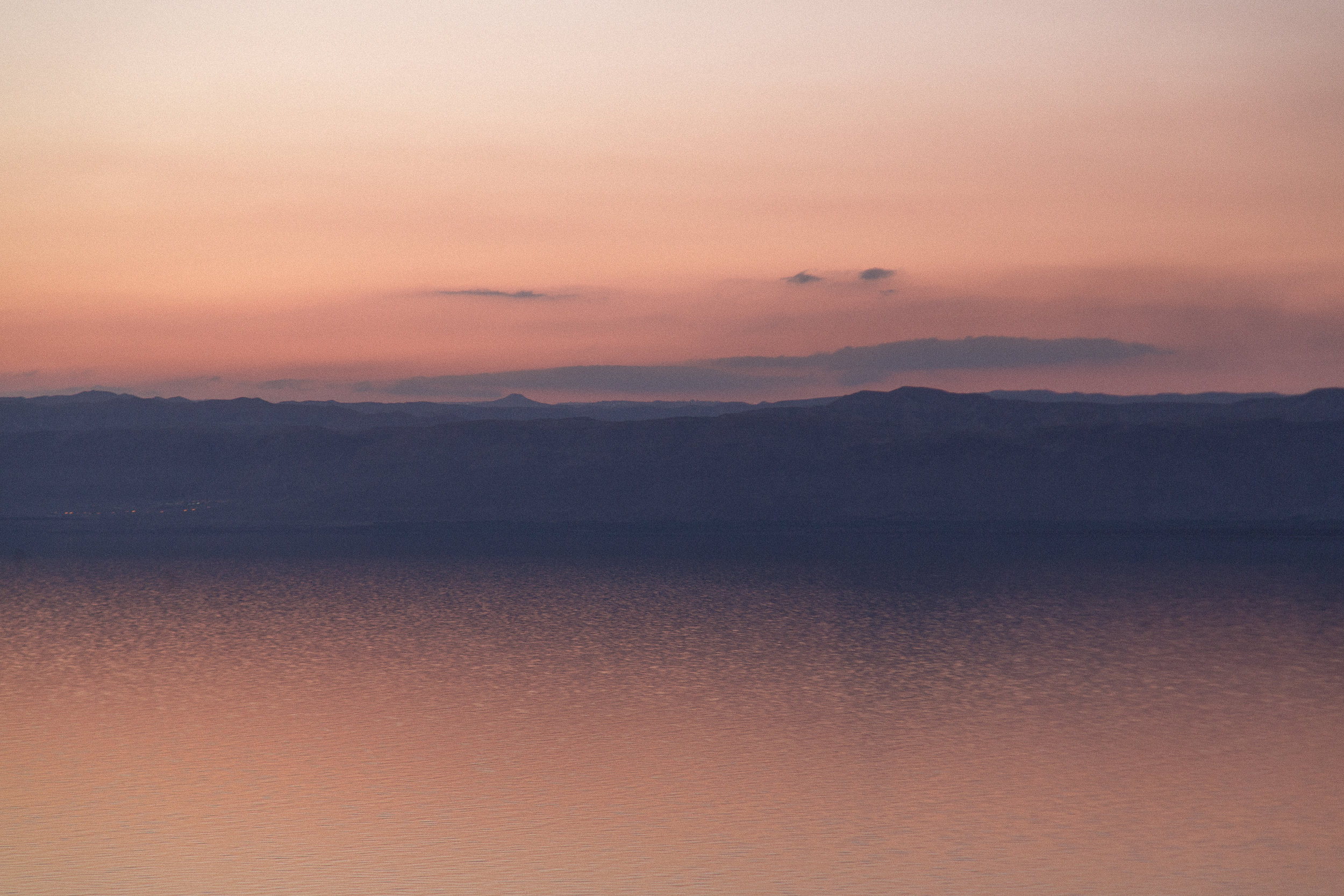 The eerie sunsets over the Dead Sea. Israel and Palestine is just a few miles away