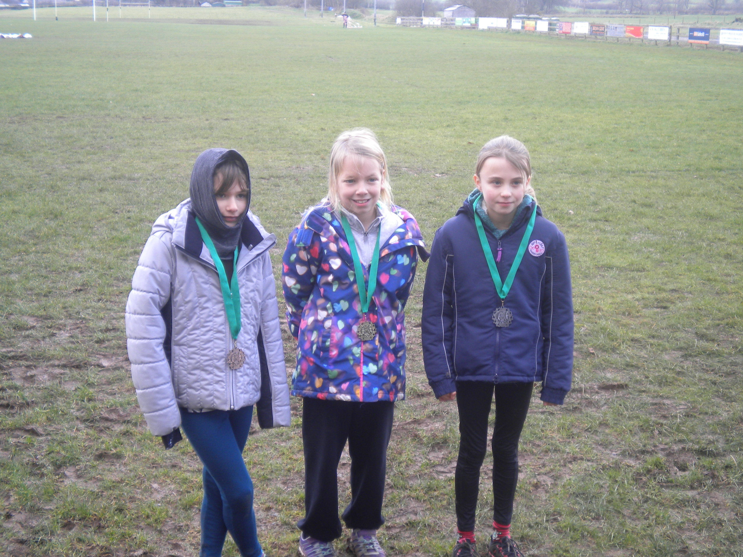 The P5 girls who were successful in the medals.  That is T on the left.